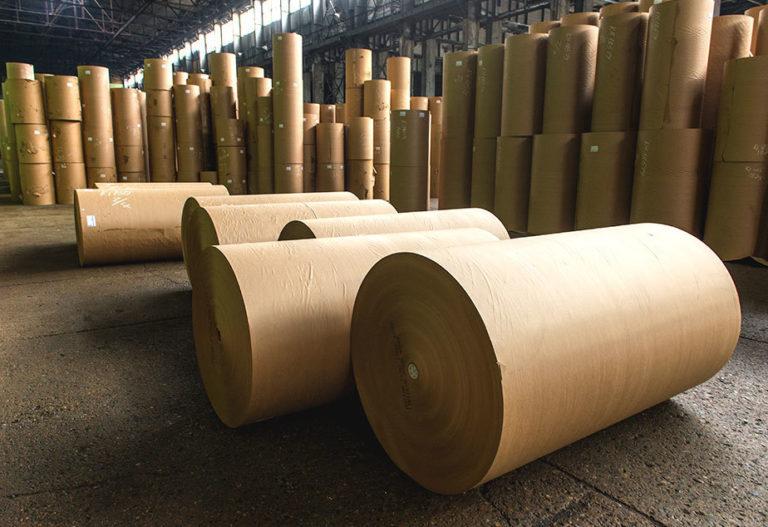beige rolls of paper in warehouse floor stacked
